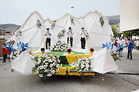 Switzerland. Canton of Neuchâtel. Neuchâtel. Grape Harvest Festival. The flower parade (corso) with its creative vehicles. Three men play the traditional Alps horns in front of fake white snowy mountains. © 2006 Didier Ruef .