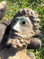 BNPS.co.uk (01202 558833)<br /> Pic: James Spark/BNPS<br /> <br /> Bust of Roman Emperor Marcus Aurelius just after it was found<br /> <br /> Two metal detectorists are today celebrating after a 'nationally important' Roman bronze hoard of artefacts they dug up sold for £240,500<br /> <br /> James Spark and Mark Didlick uncovered the bust of emperor Marcus Aurelius last year alongside a statuette of the god of Mars on horseback, a horse-head knife handle and a large bronze pendulum.<br /> <br /> The immaculately preserved items were buried in a field in Ryedale, North Yorks, as an offering to the gods as part of a Roman religious ceremony in about 160AD.