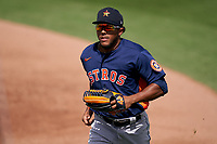 Houston Astros center fielder Pedro Leon (98) jogs to the dugout during a Major League Spring Training game against the Miami Marlins on March 21, 2021 at Roger Dean Stadium in Jupiter, Florida.  (Mike Janes/Four Seam Images)