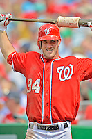 22 July 2012: Washington Nationals rookie outfielder Bryce Harper stands on deck during a game against the Atlanta Braves at Nationals Park in Washington, DC. The Nationals defeated the Braves 9-2 to split their 4-game weekend series. Mandatory Credit: Ed Wolfstein Photo