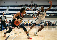 WASHINGTON, DC - JANUARY 29: Maceo Jack #14 of George Washington defends against Carter Collins #24 of Davidson during a game between Davidson and George Wshington at Charles E Smith Center on January 29, 2020 in Washington, DC.