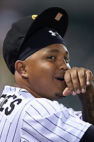 Yermin Mercedes (27) watches from the dugout during the game against the Gwinnett Braves at BB&T BallPark on July 12, 2019 in Charlotte, North Carolina. The Stripers defeated the Knights 9-3. (Brian Westerholt/Four Seam Images)