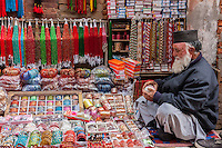 Nepal, Patan.  Vendor of Necklaces and Bracelets in his Shop in Durbar Square.