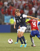 USMNT midfielder Stuart Holden (11) attempts to control the ball. In CONCACAF Gold Cup Group Stage, the U.S. Men's National Team (USMNT) (blue/white) defeated Costa Rica (red/blue), 1-0, at Rentschler Field, East Hartford, CT on July 16, 2013.