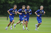Shaun Derry, Luke Young, Jamie Mackie and Clint Hill of QPR in training