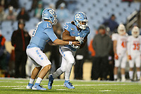CHAPEL HILL, NC - NOVEMBER 23: Josh Henderson #23 of the University of North Carolina is handed the ball by Vincent Amendola #13 during a game between Mercer University and University of North Carolina at Kenan Memorial Stadium on November 23, 2019 in Chapel Hill, North Carolina.