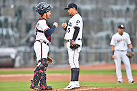 Southern Division catcher Brett Cumberland (28) of the Rome Braves and pitcher Alejandro Requena (15) of the Asheville Tourists discuss signals during the South Atlantic League All Star Game at Spirit Communications Park on June 20, 2017 in Columbia, South Carolina. The game ended in a tie 3-3 after seven innings. (Tony Farlow/Four Seam Images)