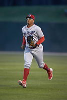 Lakewood BlueClaws right fielder Jhailyn Ortiz (13) jogs off the field between innings of the game against the Kannapolis Intimidators at Kannapolis Intimidators Stadium on April 6, 2018 in Kannapolis, North Carolina.  The BlueClaws defeated the Intimidators 4-3. (Brian Westerholt/Four Seam Images)