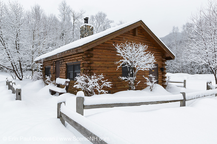 Log cabin restroom at Lincoln Woods Trailhead in Lincoln, New Hampshire USA during the winter months.