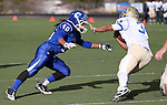 Carson's Ikela Lewis tackles Reed's Jorden Carter during the NIAA D-1 Northern Regional title game at Bishop Manogue High School in Reno, Nev., on Saturday, Nov. 29, 2014. Reed won 28-25.<br /> Photo by Cathleen Allison
