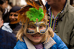 Ellie from New York enjoying the Pontchartrain Krewe parade during the first weeks of Carnival preceeding MArdi Gras in New Orleans.