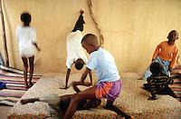Mali. Bamako. Muslim children play at home on mattresses laid on the floor. © 1997 Didier Ruef