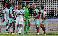 Adrian and James Collins of West Ham United square up to each other after Collins challenged his own keeper during the Barclays Premier League match between Swansea City and West Ham United played at The Liberty Stadium, Swansea on 20th December 2015
