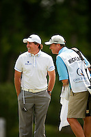 Golfer Phil Mickelson and caddie Jim McCay (right) play the course during the Quail Hollow Championship 2009 Pro-Am in Charlotte, North Carolina. The Pro-Am is held as part of the professional championship, formerly called the Wachovia Championship, which is a top event on the PGA Tour, attracting such popular golf icons as Tiger Woods, Vijay Singh and Bubba Watson.