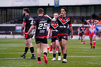 Jacob JONES (25) of London Broncos celebrates with Josh WALTERS (13) of London Broncos after he scores his first try during the Betfred Challenge Cup Round One match between London Broncos and Keighley Cougars at The Rock, Rosslyn Park, London, England on 20 March 2021. Photo by David Horn.