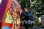 Artist Damien Slattery working on a mural of Dusty Springfield in Denny Street on Wednesday.