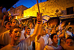 Israeli youth Chant anti Muslim slogans and wave flags in Jerusalem old walled city Wednesday May 28 2014,during festivities marking Jerusalem day. The Day marks the reunification of Jerusalem following the 1967 Six Day War when Israel captured the Arab part of the city from Jordan. Photo By Eyal Warshavsky