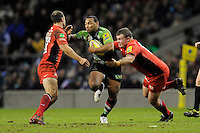 Jordan Turner-Hall of Harlequins is tackled by Matt Stevens (right) and Charlie Hodgson of Saracens during the Aviva Premiership match between Harlequins and Saracens at Twickenham on Tuesday 27 December 2011 (Photo by Rob Munro)