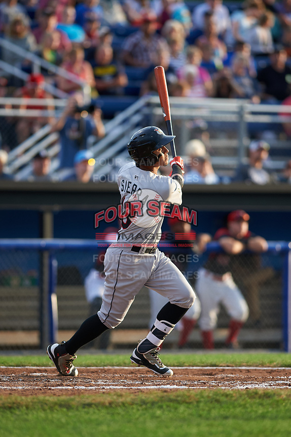 Tri-City ValleyCats shortstop Miguelangel Sierra (13) follows through on a swing during a game against the Batavia Muckdogs on July 14, 2017 at Dwyer Stadium in Batavia, New York.  Batavia defeated Tri-City 8-4.  (Mike Janes/Four Seam Images)