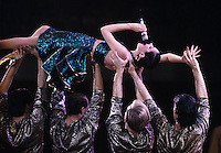 Montreal (Qc) CANADA - File Photo - circa 1987 - Jano Bergeron carried by her dancers.<br /> <br /> -Photo (c)  Images Distribution