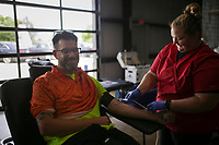 """Collection staff Jessica Mitchell (right) draws blood Ryan Patterson of Rogers (left), Friday, June 4, 2021 during a blood drive at Absolute Heat & Air in Lowell. The Red Cross held a blood drive with the goal of collecting 15 units. """"We're at a critical need of blood right now,"""" said Red Cross Team Lead Sharm Bloomingdale. """"When school is on, you get more donations. Summer months you don't have schools anymore."""" Check out nwaonline.com/210605Daily/ for today's photo gallery. <br /> (NWA Democrat-Gazette/Charlie Kaijo)"""