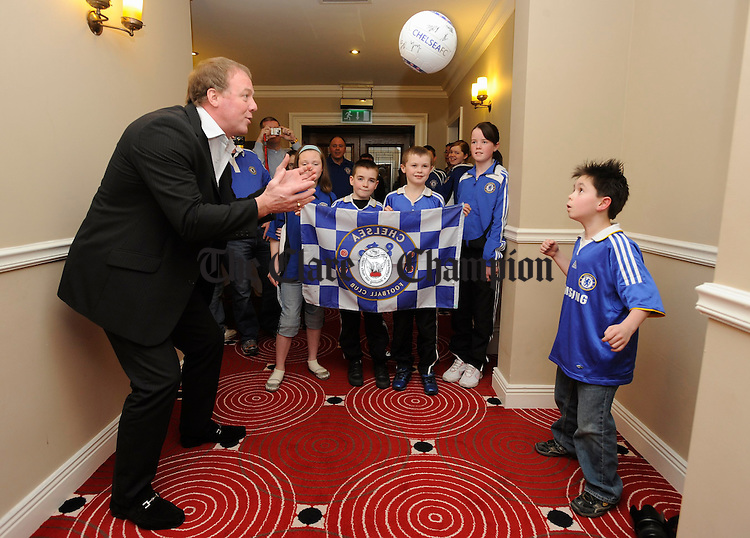 Eight year old Ethan Butler exchanges a few headers with Kery Dixon watched by fellow Chelsea supporters during his visit to the Chelsea supporters club in Ennis. Photograph by John Kelly.