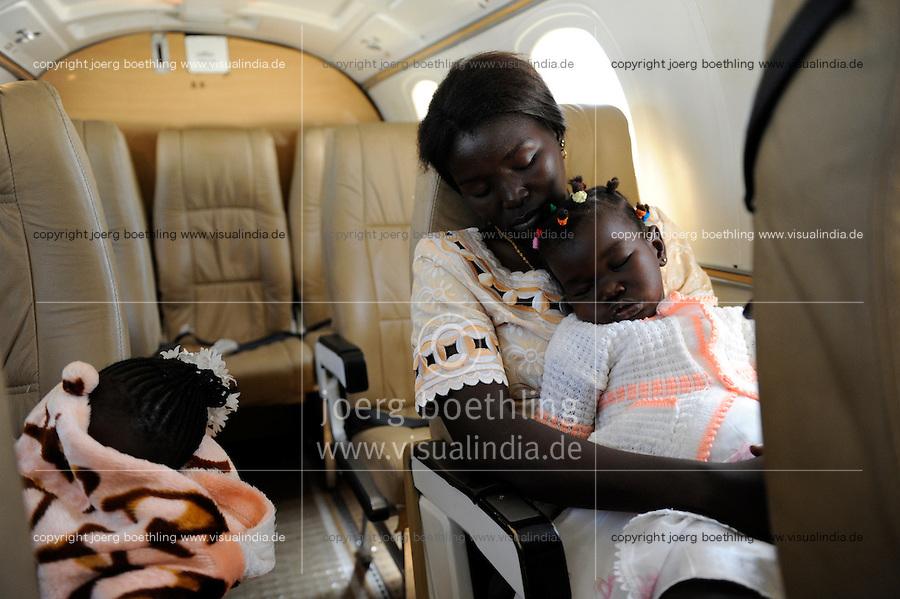 South Sudan Rumbek, Dinka woman with girl travel by air with ALS from Nairobi Wilson Airport to Rumbek, South Sudan / Suedsudan Rumbek , Dinka Frau mit Maedchen reist per Flugzeug der ALS von Nairobi nach Rumbek