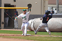 Clinton LumberKings first baseman Ryan Costello (13) reaches for throw as Bowling Green runner Vidal Brujan approaches the bag during a game during the game against the Bowling Green Hot Rods at Ashford University Field on May 2, 2018 in Clinton, Iowa.  (Dennis Hubbard/Four Seam Images)