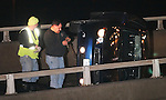WATERBURY, CT 01/01/08-010108BZ05- Tow truck operators from Bobkat Towing in Waterbury prepare to right a car that flipped onto its side on the offramp from I-84 east onto Route 8 north Tuesday night.  <br /> Jamison C. Bazinet Republican-American