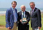 Brian Huggett MBE, (middle) the Welsh professional golfer is presented with a new Rolex watch by European Tour chief George O'Grady (left) in the clubhouse of The Royal Porthcawl Golf Club in South Wales ahead of The Senior Open Golf Tournament which begins tomorrow.