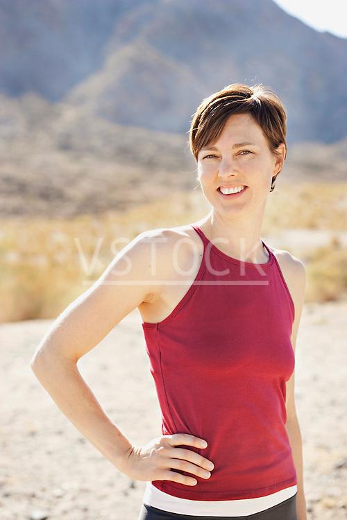 USA, California, La Quinta, Portrait of woman in desert landscape