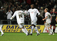 Pictured: Jason Scotland of Swansea (R) is celebrating his first goal against Barnsley with team mate Jordi gomez (L)<br /> Re: Coca Cola Championship, Swansea City FC v Barnsley at the Liberty Stadium. Swansea, south Wales, Tuesday 09 December 2008.<br /> Picture by D Legakis Photography / Athena Picture Agency, Swansea 07815441513