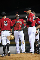 Hickory Crawdads manager Corey Ragsdale (24) flips the baseball as he waits for his new pitcher to enter the game against the Charleston RiverDogs at L.P. Frans Stadium on August 25, 2015 in Hickory, North Carolina.  The Crawdads defeated the RiverDogs 7-4.  (Brian Westerholt/Four Seam Images)