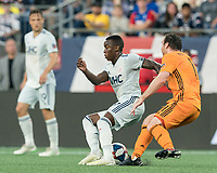 FOXBOROUGH, MA - JUNE 29: Luis Caicedo #27 attempts to control the ball as Tommy McNamara #11 pressures during a game between Houston Dynamo and New England Revolution at Gillette Stadium on June 29, 2019 in Foxborough, Massachusetts.