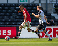 18th July 2021; Pride Park, Derby, East Midlands; Pre Season Friendly Football, Derby County versus Manchester United;  Mason Greenwood of Manchester United being tracked by  Graeme Shinnie of Derby County