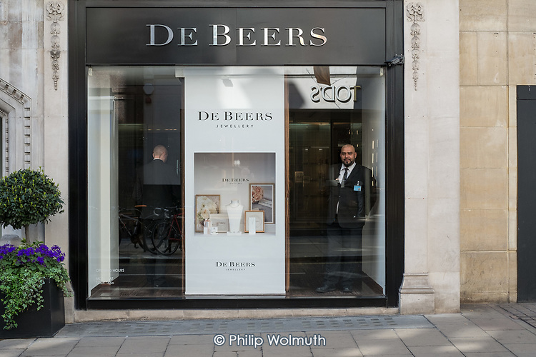 Security guards at the entrance to De Beers jewellery store, Old Bond Street, Mayfair, London.