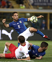 Football: Uefa Nations League match Italy vs Poland, Renato Dall'Ara stadium, Bologna, Italy, September 7, 2018. <br /> Italy's Giacomo Bonaventura (top) in action with his teammate Roberto Gagliardini (r) and Poland's Bartosz Bareszynski (l) during the Uefa Nations League match between Italy and Poland at the Renato Dall'Ara stadium, Bologna, Italy, September 7, 2018. <br /> UPDATE IMAGES PRESS/Isabella Bonotto