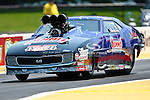 Ken Lang (6) driver for the Summit Racing team makes a pass during the O'Reilly Auto Parts Spring Nationals at the Royal Purple Raceway in Baytown,Texas.