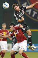 DC United midfielder Ben Olsen (14) heads the ball and is covered by NY midfielder Danny O'Rourke (3). DC United defeated the New York Red Bulls 4-3. DC United earned a top seed in the 2006 MLS Playoffs and will enjoy home field advantage for the entire Eastern Conference Playoffs. Saturday, September 23, 2006, at RFK Stadium.