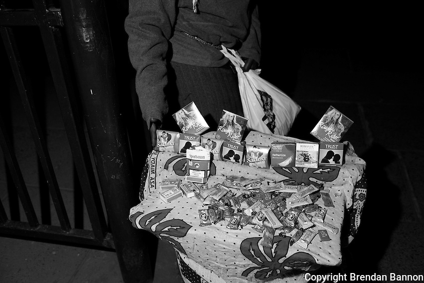 """""""Mama Condom"""" sells condoms, gum, candy and cigarettes outside a night club in Nairobi's city center."""