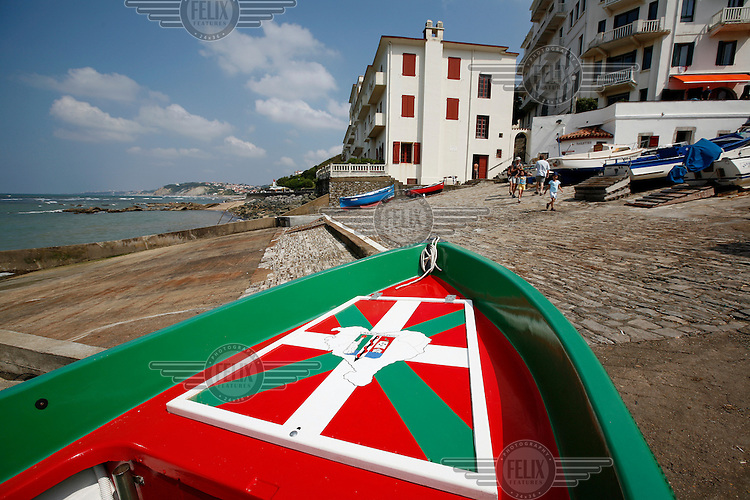 Small fishing vessel decorated with the Basque colors. Village near Biarritz, France.