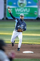 West Michigan Whitecaps shortstop Corey Joyce (7) makes a throw to first base against the Great Lakes Loons at LMCU Ballpark on May 11, 2021 in Comstock Park, Michigan. (Andrew Woolley/Four Seam Images)