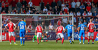 Goalkeeper Alex Cairns of Fleetwood Town saves a penalty during the Sky Bet League 1 match between Fleetwood Town and Peterborough at Highbury Stadium, Fleetwood, England on 19 April 2019. Photo by Stefan Willoughby.