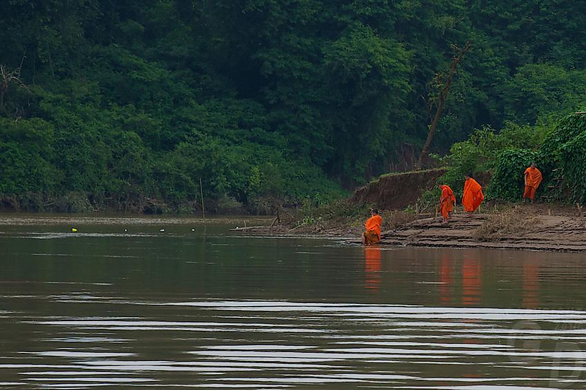 Monks on the banks of the Mekong River at Luang Prabang, Laos