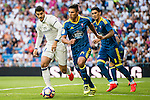 Alvaro Morata of Real Madrid (l) and Facundo Roncaglia of Celta de Vigo fight for the ball during their La Liga match at the Santiago Bernabeu Stadium between Real Madrid and RC Celta de Vigo on 27 August 2016 in Madrid, Spain. Photo by Diego Gonzalez Souto / Power Sport Images