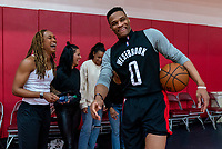 HOUSTON, TX - FEBRUARY 1: Jess McDonald #14 of the United States laughs with Russell Westbrook of the Houston Rockets at Houston Rockets Training Center on February 1, 2020 in Houston, Texas.