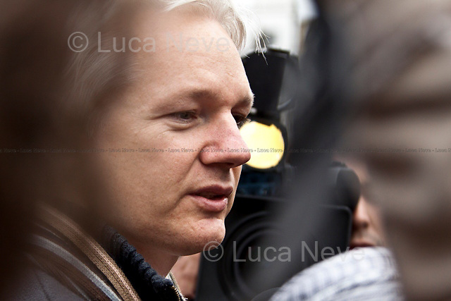 """Julian Assange - 2011<br /> <br /> London, 08/10/2011. Today Trafalgar Square was the stage of the """"Antiwar Mass Assembly"""" organised by The Stop The War Coalition to mark the 10th Anniversary of the invasion of Afghanistan. Thousands of people gathered in the square to listen to speeches given by journalists, activists, politicians, trade union leaders, MPs, ex-soldiers, relatives and parents of soldiers and civilians killed during the conflict, and to see the performances of actors, musicians, writers, filmmakers and artists. The speakers, among others, included: Jeremy Corbin, Joe Glenton, Seumas Milne, Brian Eno, Sukri Sultan and Shadia Edwards-Dashti, Hetty Bower, Mark Cambell, Sanum Ghafoor, Andrew Murray, Lauren Booth, Kate Hudson, Sami Ramadani, Yvone Ridley, Mark Rylance, Dave Randall, Roger Lloyd-Pack, Rebecca Thorn, Sanasino al Yemen, Elvis McGonagall, Lowkey (Kareem Dennis), Tony Benn, John Hilary, Bruce Kent, John Pilger, Billy Hayes, Alison Louise Kennedy, Joan Humpheries, Jemima Khan, Julian Assange, Lindsey German, George Galloway. At the end of the speeches a group of protesters marched toward Downing Street where after a peaceful occupation the police made some arrests."""