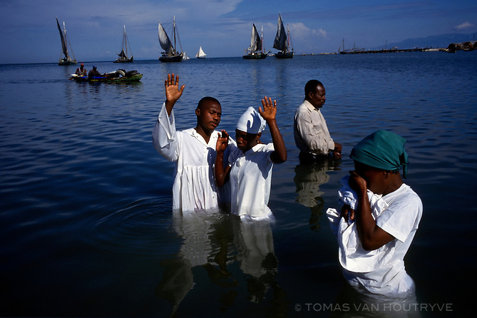 Protestants perform a baptism ceremony in Port-au-Prince, Haiti on Sunday, September 3, 2000. Protestant, Catholic and Voodoo religions are practiced in Haiti.