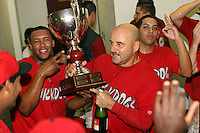 September 15 2008:  Mark DeJohn, Miguel Tapia, Rigoerto Lugo of the Batavia Muckdogs, Class-A affiliate of the St. Louis Cardinals, celebrate winning the NY-Penn League championship after a game at Dwyer Stadium in Batavia, NY.  Photo by:  Mike Janes/Four Seam Images