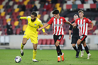 Michael Hector of Fulham in possession as Brentford's Christian Norgaard looks on during Brentford vs Fulham, Caraboa Cup Football at the Brentford Community Stadium on 1st October 2020